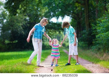 Family Hiking In A Pine Wood
