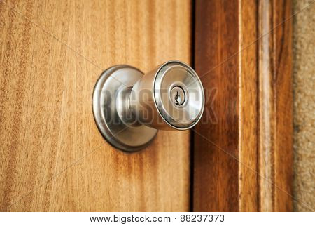 Shining Metal Door Handle With Keyhole, Closeup