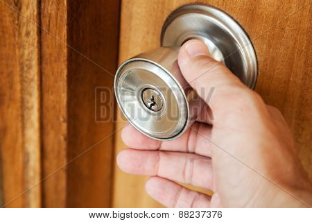 Male Hand Opening Shining Metal Door Handle