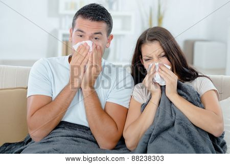 Couple sick on the sofa