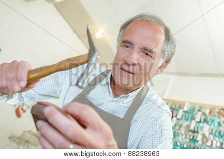 Cobbler hammering