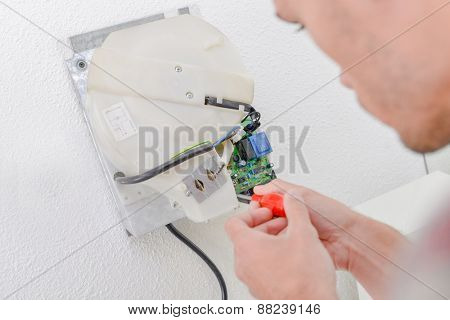 Man repairing a broken dryer