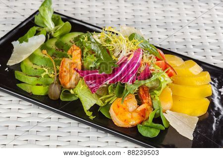 salad with mango and shrimp on a light background