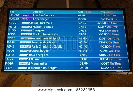 KEFLAVIK, ICELAND - March 15, 2015: Airport departure board screen at Keflavik International Airport