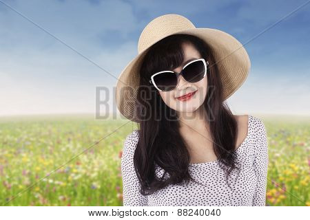 Beautiful Woman With Sun glasses At Field