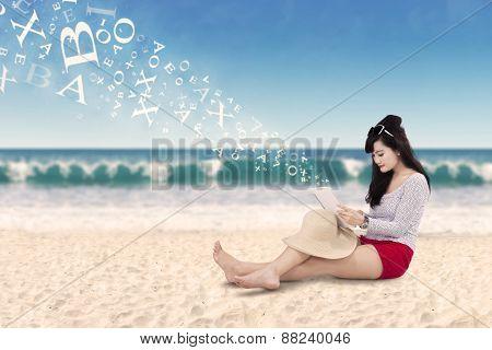 Beautiful Woman Using Tablet At Coast
