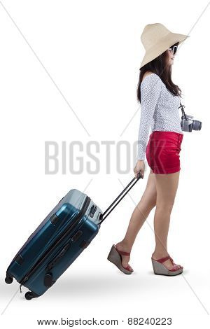 Female Traveller Carrying A Suitcase