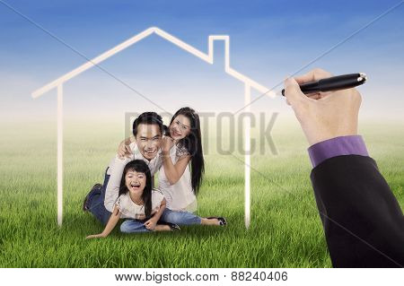 Family Laughing Under A Dream Home