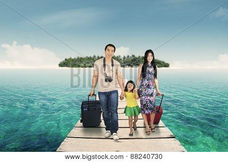 Happy Family Walking On Bridge