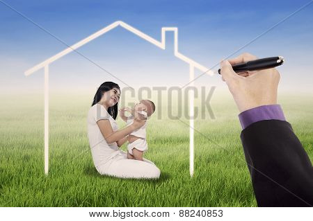 Mother With Her Daughter Under A Dream Home