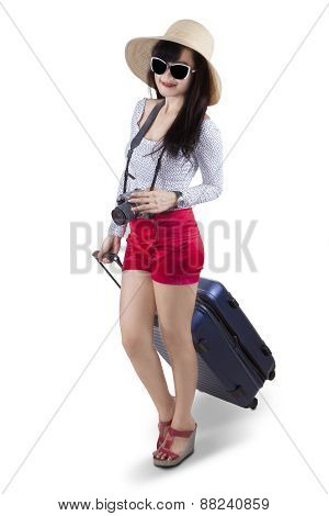 Modern Tourist Carrying A Suitcase