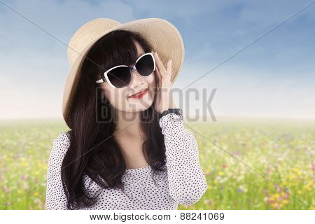 Pretty Model With Long Hair At Meadow