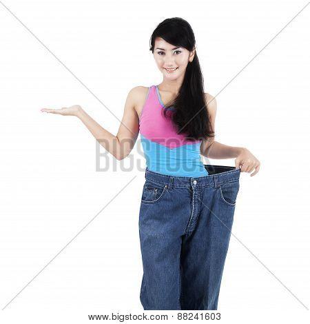 Slim Woman With Presentation Gesture