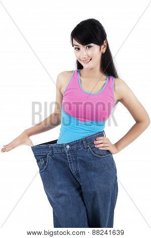Slim Woman With Her Old Jeans