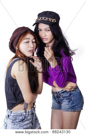 Two Female Teenager Gossiping