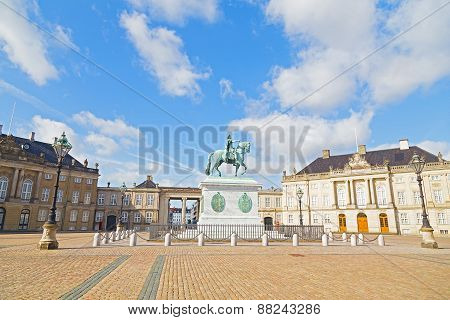 Amalienborg Palace with an octagonal courtyard square and statue in Copenhagen Denmark.
