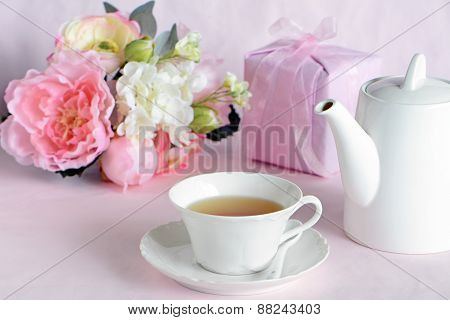 Lovely Flowers With Gift And Cup Of Tea