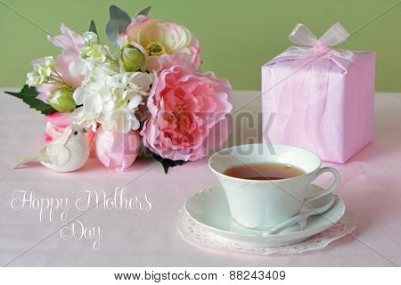 Mother's Day  Flowers With Gift And Cup Of Tea