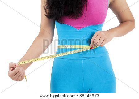 Woman Measure Her Belly After Exercise