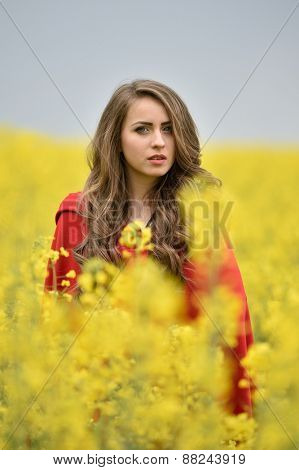 beautiful woman on blooming rapeseed field in spring