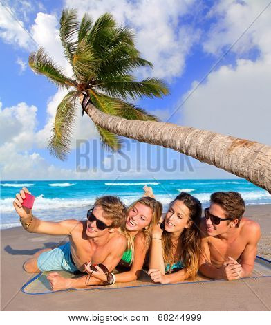 Beach friends together tourist portrait on the sand smiling happy