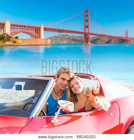 selfie of young teen couple at convertible car in San Francisco Golden Gate Bridge photo mount