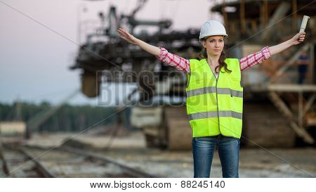 female worker gives a signal on background of career stacker