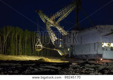 night view of absetzer with lighted spotlights focus on top of the crane boom
