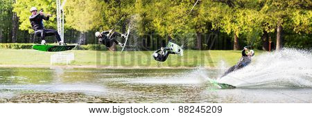 Male wakeboarder  jumps on pond in park