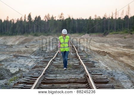 female worker goes along the tracks