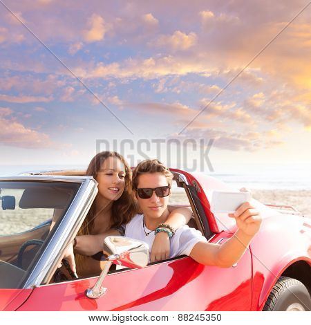 selfie photo of young teen couple in convertible sports car