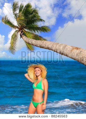 blond tourist girl in a tropical summer beach happy vacations Caribbean coconut palm tree