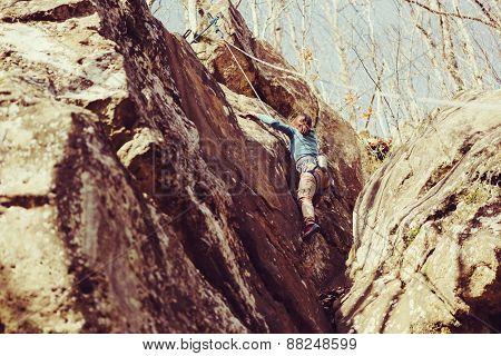 Girl Climbing Rock Outdoor