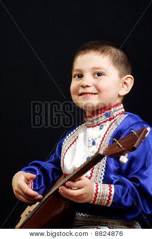Smiling Boy With Balalaika