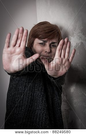 Scared and abused woman