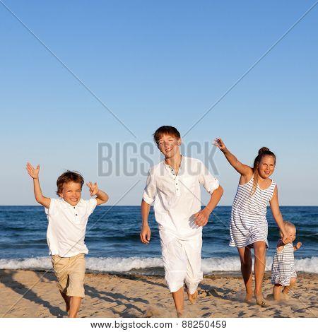 Children Are Running On Beach