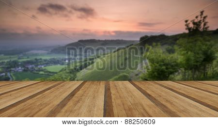 Vibrant Sunrise Over Countryside Landscape With Wooden Planks Floor