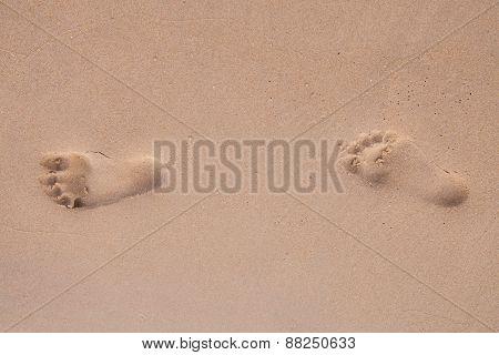 Footprints On The Beach.