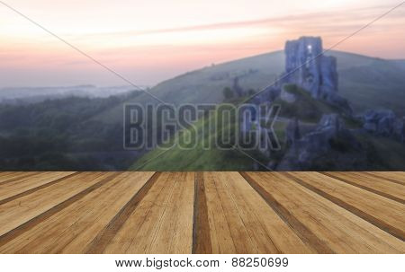 Romantic Fantasy Magical Castle Ruins Against Stunning Vibrant Sunrise With Wooden Planks Floor
