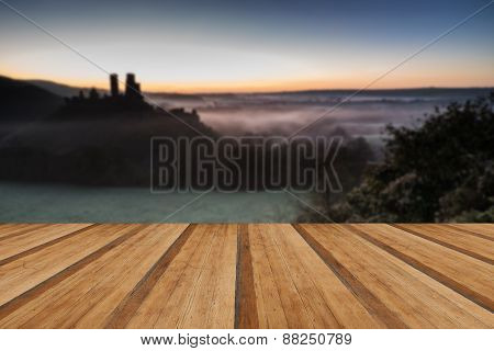 Medieval Castle Ruins With Foggy Landscape At Sunrise With Wooden Planks Floor