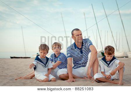 Portrait Of Happy Family Near Yacht