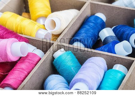Multicolored Threads In Wooden Box