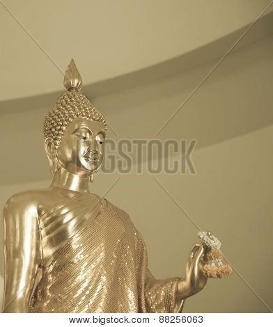Golden Buddha Statue Hold Marigold Garland