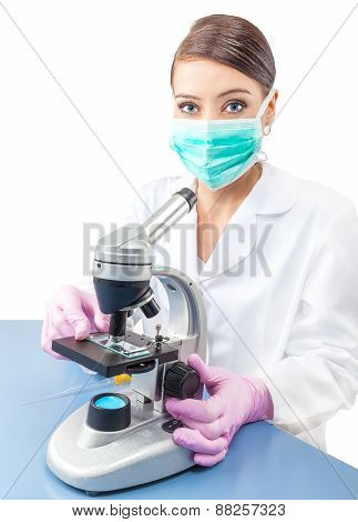 Woman Using A Microscope In A Laboratory.