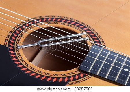 Music Tuning Fork On Acoustic Guitar Strings