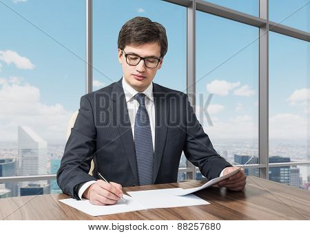 Handsome Legal Consultant Is Dealing With Due Diligence Process In A Modern Skyscraper Office With A