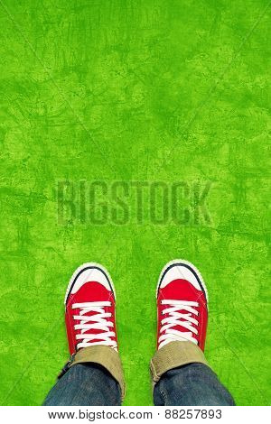Feet From Above, Teenager In Sneakers Standing On Green Background