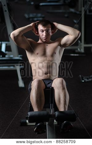 Young Man Trains The Abdominal Muscles Of The Abdomen