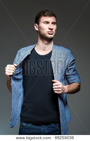 Studio Fashion Shot: Portrait Of Handsome Young Man Wearing Jeans And Shirt