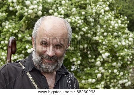 Smiling Bald Man With A Beard